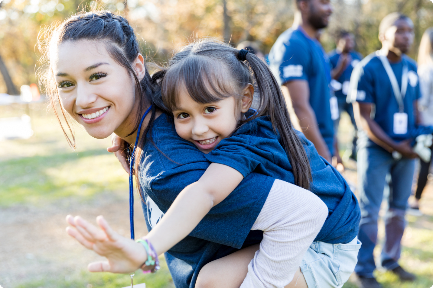 Female volunteer with little girl